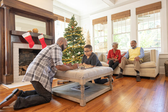Family playing games during Christmas