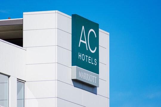AC Hotels Marriott logo and sign on a European inspired hotel under blue sky - South San Francisco, California, USA, California, USA - 2020