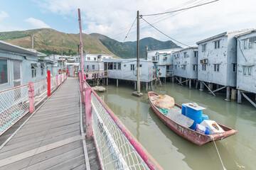 Fototapete - Residential stilt house with tin siding and foot bridge in Tai O fishing village, Lantau island, Hong Kong