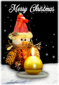 Christmas pine snowman and gold candle against a snow and black sky background