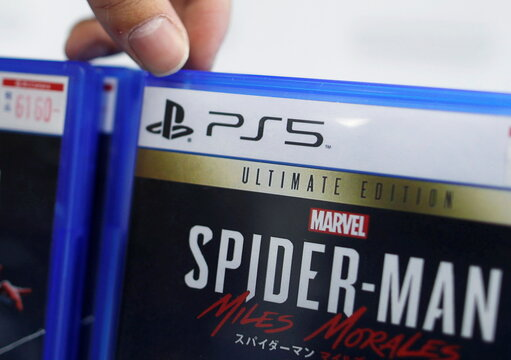 The logo of Sony PlayStation 5 is seen on the package of its gaming software at the consumer electronics retailer chain Bic Camera, ahead of the game console's official launch, in Tokyo