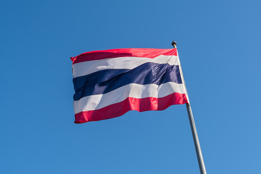 Thailand flag with blue sky as background