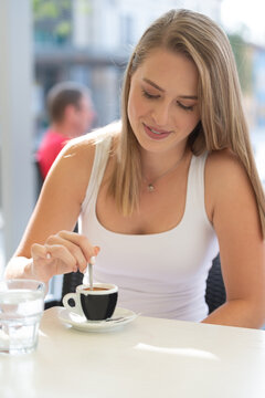Happy pensive woman thinking in a coffee shop terrace in the street.