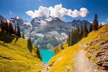Wall Mural - Magnificent view of the lake Oeschinensee in sunny day. Location place Swiss alps, Kandersteg district, Europe.