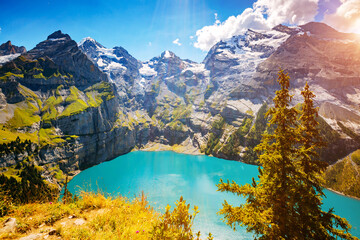 Wall Mural - Spectacular view of the lake Oeschinensee in sunny day. Location place Swiss alps, Kandersteg district, Europe.