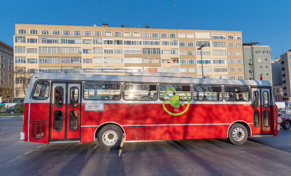 Istanbul, Turkey - April 14, 2019: Electric red bus a part of public transportation system in Istanbul. Green urban ecology concept of e-bus. Zero emission transport in city.