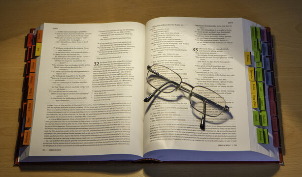 LUTON, UNITED KINGDOM - Oct 25, 2020: An open bible and glasses