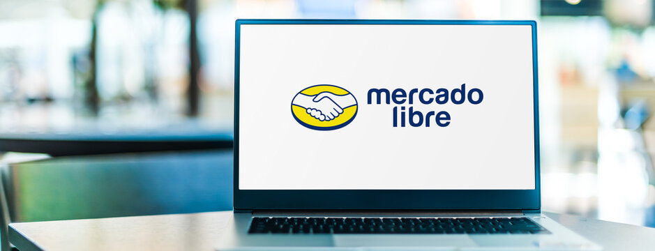Laptop computer displaying logo of Mercado Libre