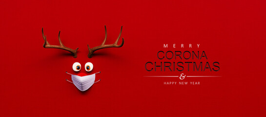 Reindeer toy with cold red nose and medical mask on red Christmas Corona background 3D Rendering