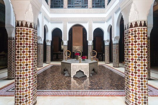 Interior of a riad with pillars and islamic patterns mosaic