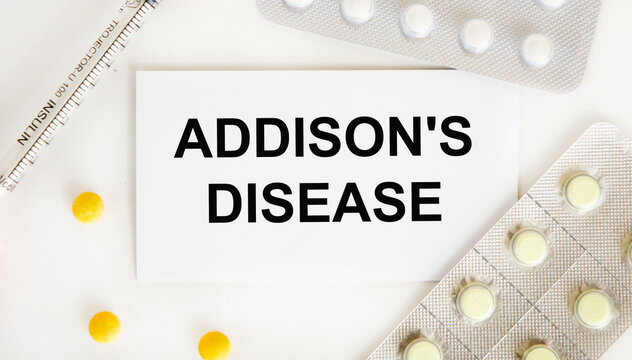 On the card is the text of ADDISON'S DISEASE, next to blisters with tablets and a syringe.
