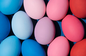 Easter eggs on pastel background. Creative easter concept.