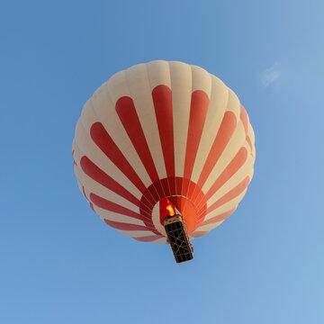A hot air baloon against a blue sky.