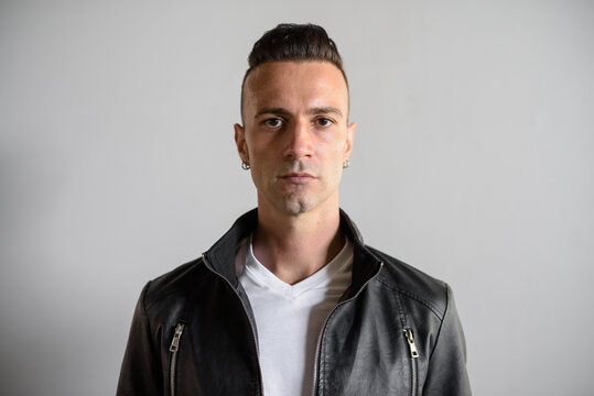 Handsome young Italian man with undercut wearing black leather jacket