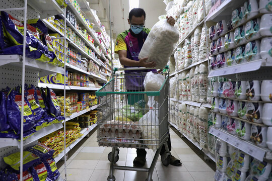 Malaysian former pilot Azrin Mohamad Zawawi shops for groceries for his food stall at a supermarket in Subang Jaya