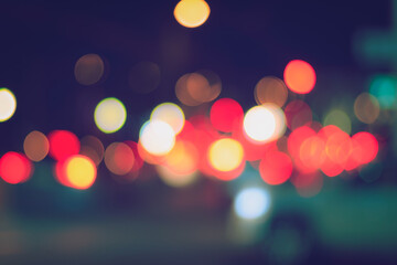 Blurred lights of headlights of cars and lanterns in the night city. Abstract bokeh. Fotomurales