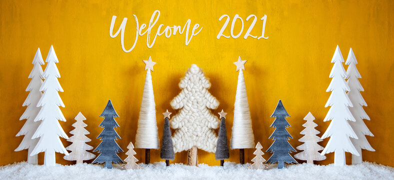 Banner Of Christmas Trees With English Calligraphy Welcome 2021. Yellow Wooden Rustic Background With Snow. Christmas Decoration With Stars.