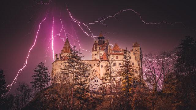 Spectacular thunder over Bran Castle, Transylvania, Romania. A medieval building known as Castle of Dracula.