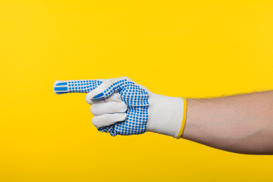 Worker work glove isolated on yellow background