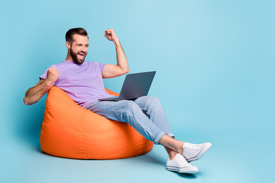Full length body size photo of bearded freelancer gesturing like winner laptop isolated on vibrant blue color background