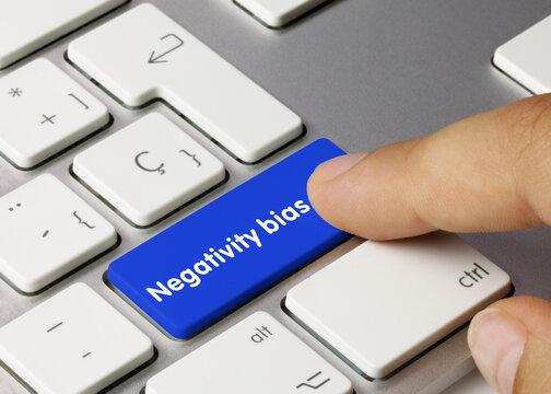 Negativity bias - Inscription on Blue Keyboard Key.