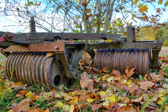 Rusty Agricultural Machinery - Old rusty agricultural device in the shape of a field roller.