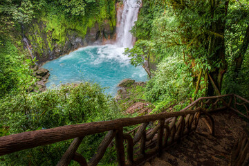 Stairs path that leads to the famous turquoise waters of Rio Celeste river, Tenorio national park, Costa Rica