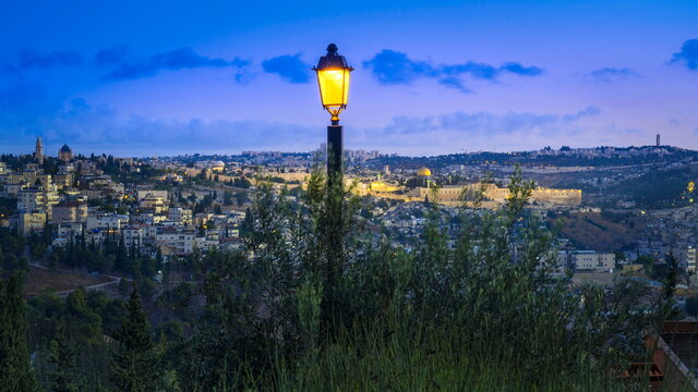Beautiful pre-dawn view from Scherover Promenade, overlooking Jerusalem - from Abu Tor and Mount Zion, across the Old city with Dome of the Rock on the Temple Mount, Hebrew University on Mount Scopus