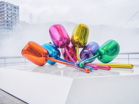 BILBAO, SPAIN-FEBRUARY 11, 2018: The Tulips are a colorful sculpture made of stainless steel by artist Jeff Koons that rests in front of the Guggenheim Museum