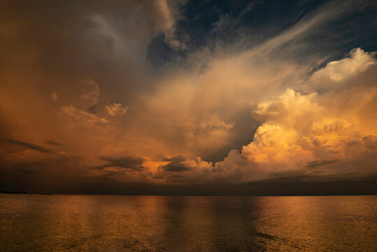 Storm Clouds and a Brilliant Sunset over Gulf in St. Petersburg, FL