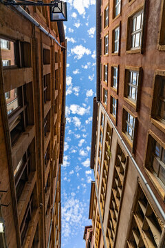 View to the sky in an old narrow street of Lyon - Lyon, Rhone, France
