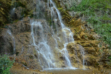 View of Caucasian waterfall with mineral water in Dzhily-Su tract