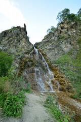 View of Caucasian summer waterfall with glacial water in Dzhily-Su tract