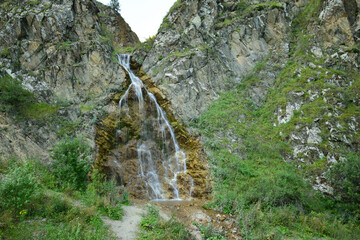 Panorama of Caucasian waterfall with glacial water in Dzhily-Su tract