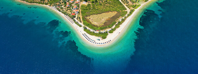 Aerial drone ultra wide panoramic view of tropical paradise sandy beach visited by sailboats and yachts in Caribbean exotic destination island