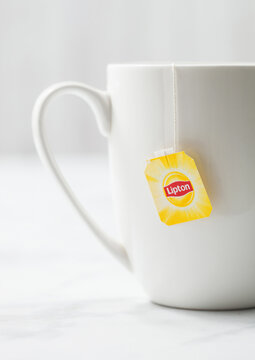 LONDON, UK - OCTOBER 21, 2020: Lipton yellow label tea bag in white porcelain cup on light