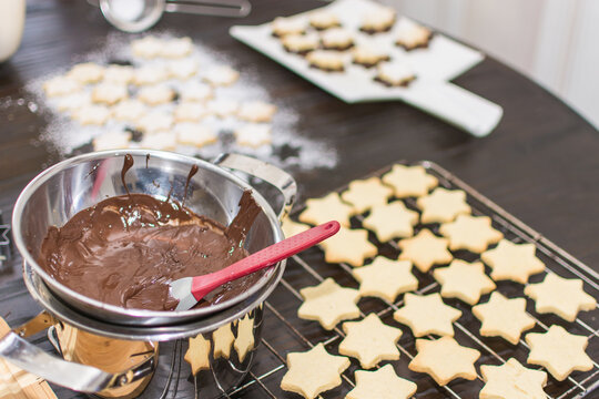 In the time before Christmas, cookies are baked at home in a star shape. Shortcrust pastry stars are covered with chocolate and sprinkled with powdered sugar.