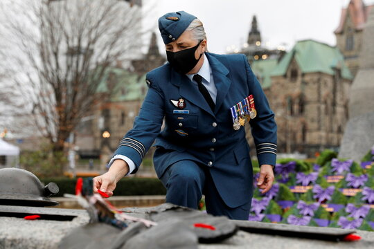 A Canadian Forces member lays a poppy on the Tomb of the Unknown Soldier following a ceremony at the National War Memorial on Remembrance Day in Ottawa