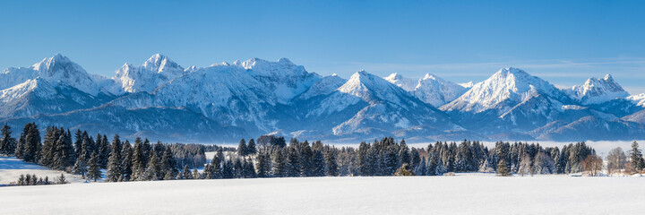 panoramic landscape at winter with alps mountains in Bavaria