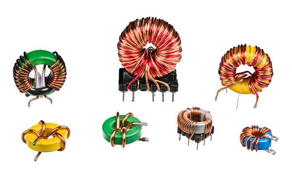 Set of electronic induction coils and transformers isolated on a white background. Various toroidal inductors with copper wire winding and ferrite core. Closeup of colored passive electric components.