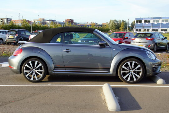 Almere, Netherlands - October 12, 2018: Grey New Beetle cabriolet parked on a public parking lot. Nobody in the vehicle.