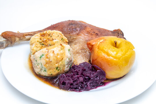 Goose drumsticks with bread dumpling and red cabbage