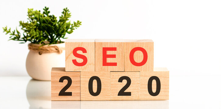 SEO 2020 word written on wood block. Faqs text on table, concept