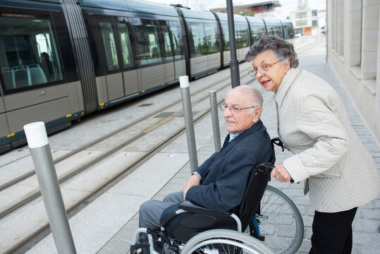 couple waiting to get in the tram