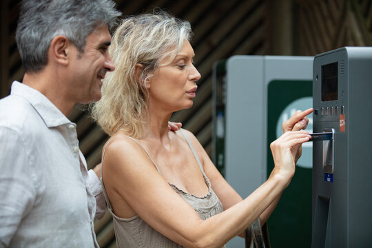 senior couple using cash machine