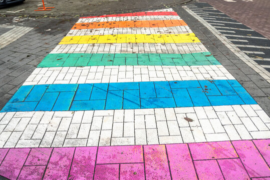 Pedestrian crossing painted in rainbow colours in a city centre. Rights of LGTBs concept.