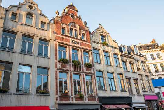 Historic architecture with colourful shopfronts in central Brussels at sunset in winter