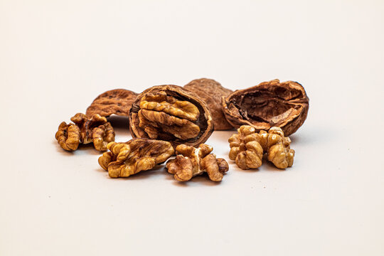 some walnuts against white background