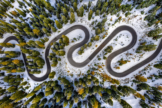 Aerial drone view of windy road during winter