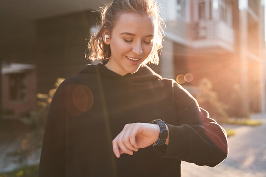 Woman checking results on smartwatch